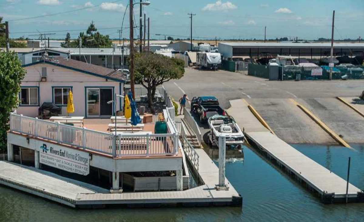 Our boat storage facility is just next door to a triple boat ramp into Delta waterways.